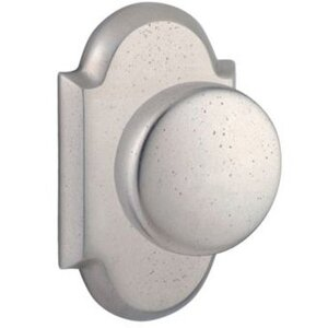 Baldwin Hardware Single Dummy Door Knob with Arch Rose in White Bronze