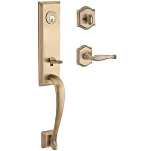Baldwin Hardware Handleset with Left Handed Decorative Lever and Traditional Arch Rose in Matte Brass & Black