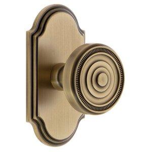 Grandeur Door Hardware Grandeur Arc Plate Double Dummy with Soleil Knob in Vintage Brass
