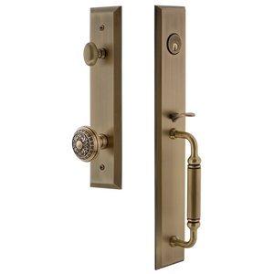 Grandeur Door Hardware One-Piece Handleset with C Grip and Windsor Knob in Vintage Brass