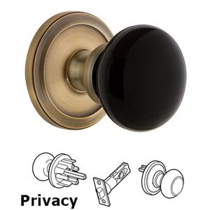 Grandeur - Privacy - Circulaire Rosette with Black Coventry Porcelain Knob in Vintage Brass