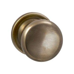 Omnia Industries Single Dummy Traditions Half Round Door Knob with Medium Radial Rosette in Antique Bronze Unlacquered