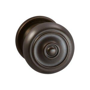 Omnia Industries Single Dummy Traditions Classic Door Knob with Medium Radial Rosette in Antique Bronze Unlacquered