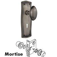 Nostalgic Warehouse - Egg & Dart - Complete Mortise Lockset with Keyhole - Egg & Dart Plate with Homestead Door Knob in Timeless Bronze